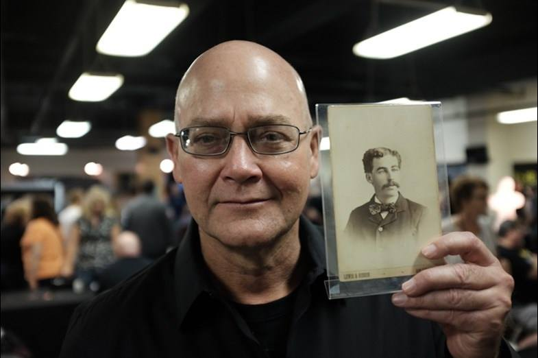 Jeff Mudgett and picture of his great-great-grandfather, serial killer H. H. Holmes